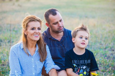 Photo for Portrait of parents with their son enjoying outdoor. - Royalty Free Image