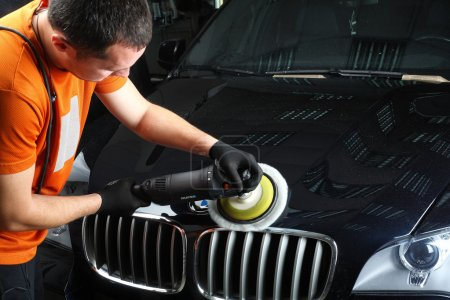 Car service. Polishing of the car