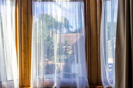Photo for Old, vintage windows with white net curtains - Royalty Free Image