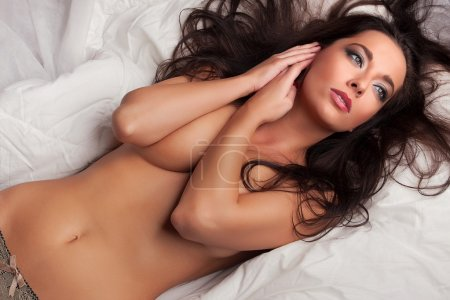 sexy brunette girl on bed