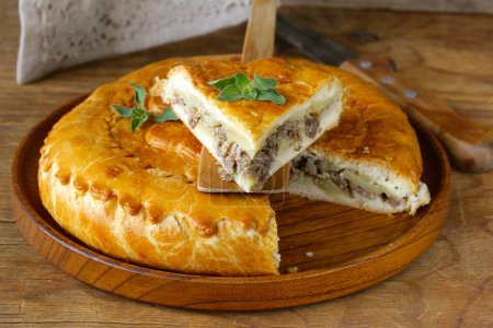 Photo for Homemade meat pie with potatoes and oregano - Royalty Free Image
