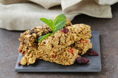 Photo for Homemade muesli bars with cranberries, nuts and chocolate - Royalty Free Image