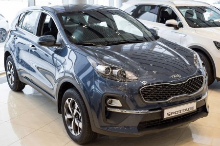 Photo for Russia, Izhevsk - December 28, 2020: KIA showroom. New Sportage car in dealer showroom. Front and side view. Famous world brand. - Royalty Free Image