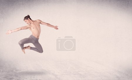 Photo for Modern ballet dancer performing art jump with empty copy space background - Royalty Free Image