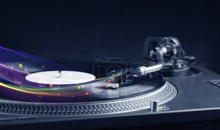 Photo for Turntable playing vinyl with glowing abstract lines concept on background - Royalty Free Image