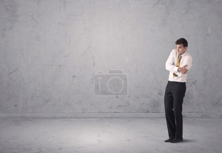 Young businessman standing confused