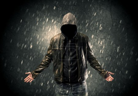 Photo for A faceless misterious man in hoodie and leather jacket standing in the dark with a visible silhouette concept - Royalty Free Image