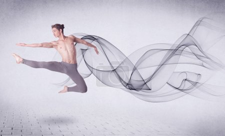 Photo for Modern ballet dancer performing with abstract swirl concept on background - Royalty Free Image