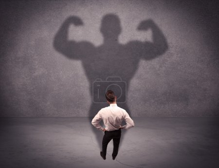 Successful businessman with strong shadow