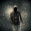 A faceless misterious man in hoodie and leather ja...