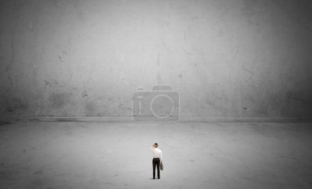 Small business person in large empty space