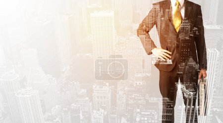 Photo for Business man with warm color overlay of city background texture - Royalty Free Image