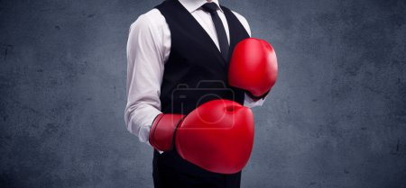 Boxing businessman with red boxing gloves