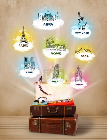 Photo for Tourist suitcase with famous landmarks around the world on grungy background - Royalty Free Image