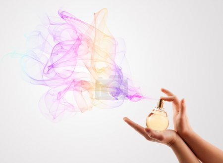 Photo for Close up of woman hands spraying perfume - Royalty Free Image
