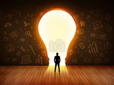 Photo for Business man looking at bright light bulb in the wall concept - Royalty Free Image
