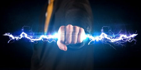 Photo for Business man holding electricity light bolt in his hands concept - Royalty Free Image