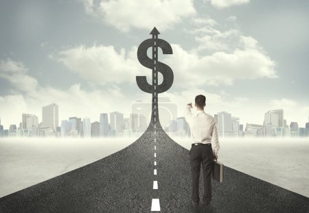 Photo for Business man on road heading toward a dollar sign concept - Royalty Free Image