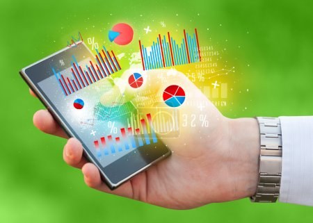 Business man holding smartphone with chart symbols