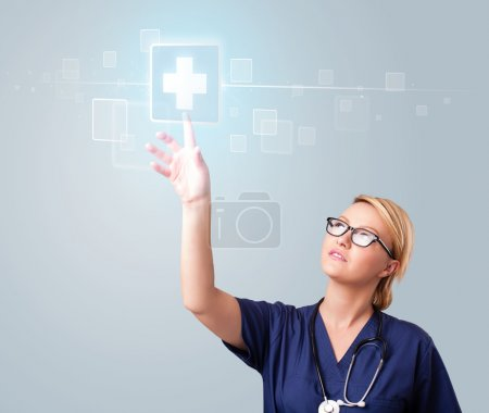 Photo for Pretty young nurse pressing modern medical type of buttons - Royalty Free Image