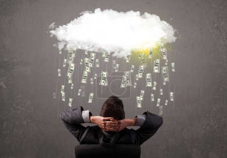 Photo for Business man in suit looking at cloud with falling money and sun - Royalty Free Image