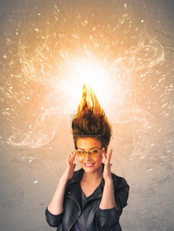 Photo for Young woman with energetic exploding red hair concept on background - Royalty Free Image