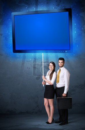 Business couple with shining tablet