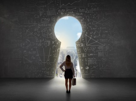 Business woman looking at keyhole with bright cityscape concept