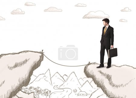 Businessman with drawn edge of mountain