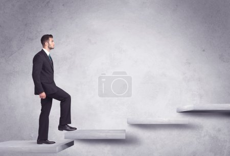 Photo for Business person stepping up a staircase - Royalty Free Image