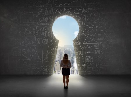 Photo for Business woman looking at keyhole with bright cityscape concept background - Royalty Free Image
