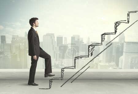 Business man climbing up on hand drawn staircase concept