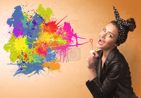 Photo for Cute girl blowing bubble spalsh graffiti into wall - Royalty Free Image