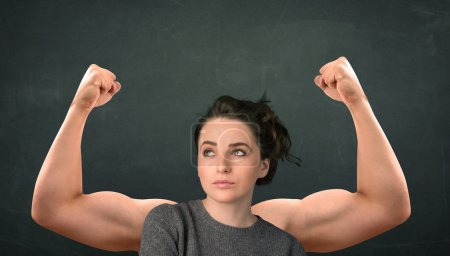 Photo for Pretty young woman with strong and muscled arms concept - Royalty Free Image