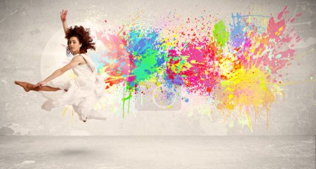 Photo for Happy teenager jumping with colorful ink splatter on urban background concept - Royalty Free Image