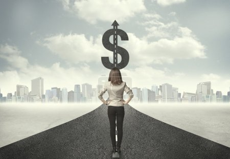 Business woman on road heading toward a dollar sign
