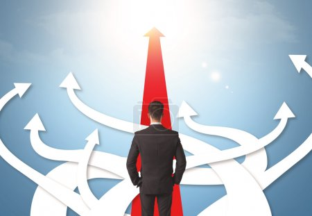 businessman with different direction arrows