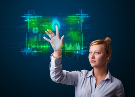 Young businesswoman pressing modern technology panel with finger