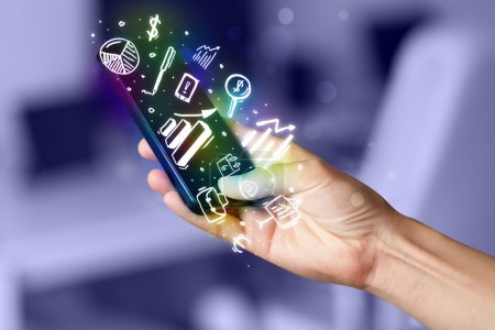 Photo for Smartphone with finance and market icons and symbols concept - Royalty Free Image
