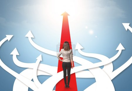 businesswoman with different direction arrows