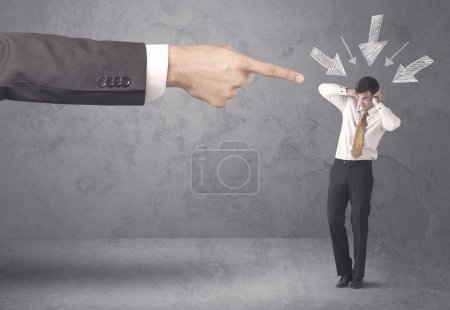 Photo for An office boss blaming young amateur and beginner business person with big hand, drawn arrows pointing at him concept - Royalty Free Image