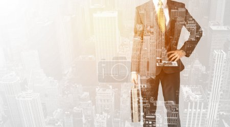 Business person with warm color overlay of city background