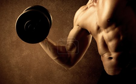 Photo for Muscular fit bodybuilder athlete lifting weight on grungy background - Royalty Free Image