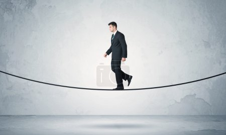 Sales guy balancing on tight rope