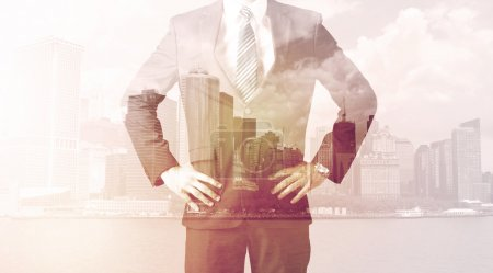 Photo for Businessman standing at cityscape background with warm light - Royalty Free Image