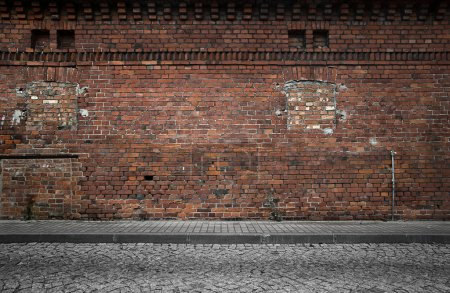 Photo for Industrial background, empty grunge urban street with warehouse brick wall - Royalty Free Image