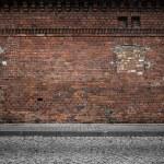 Industrial background, empty grunge urban street with warehouse brick wall