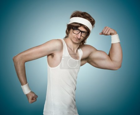 Photo for Funny retro nerd with one huge arm flexing his muscle over blue background - Royalty Free Image