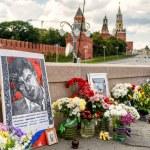 Постер, плакат: Flowers at the place of murder of Boris Nemtsov near Moscow Kre