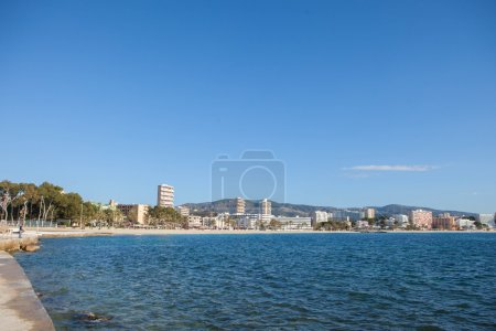 Photo for MAGALLUF, CALVIA, MALLORCA (MAJORCA) BALEARIC ISLANDS, SPAIN - 2015 Magalluf beach  was recently renamed Calvia beach.  Magalluf is in the South West of the Balearic island of Mallorca which is in the Mediterranean sea off the East coast  of Spain - Royalty Free Image